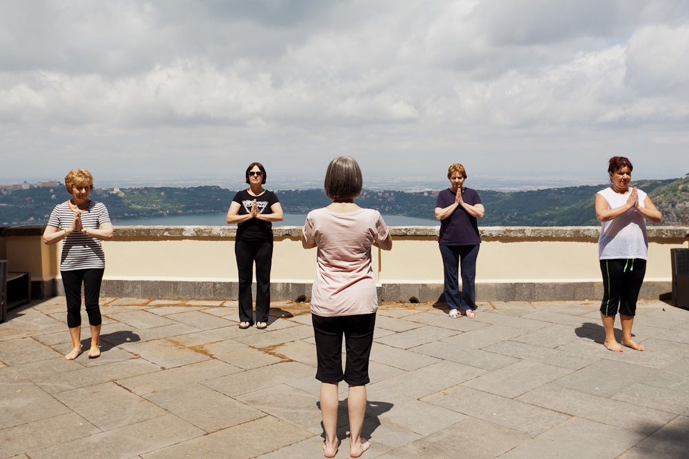 Rose and the class practicing yoga on the sun deck of the Italan Villa amidst beautiful scenery
