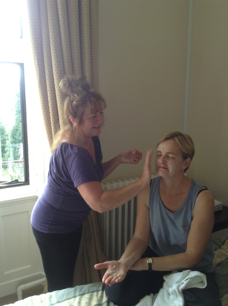 Chris applying Forever Living aloe vera facial products during last year's yoga retreat